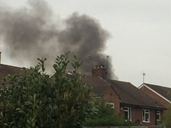Rubbish fire sets garden shed alight