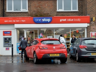 Passer-by chases after armed robbers as two Black Country shops raided