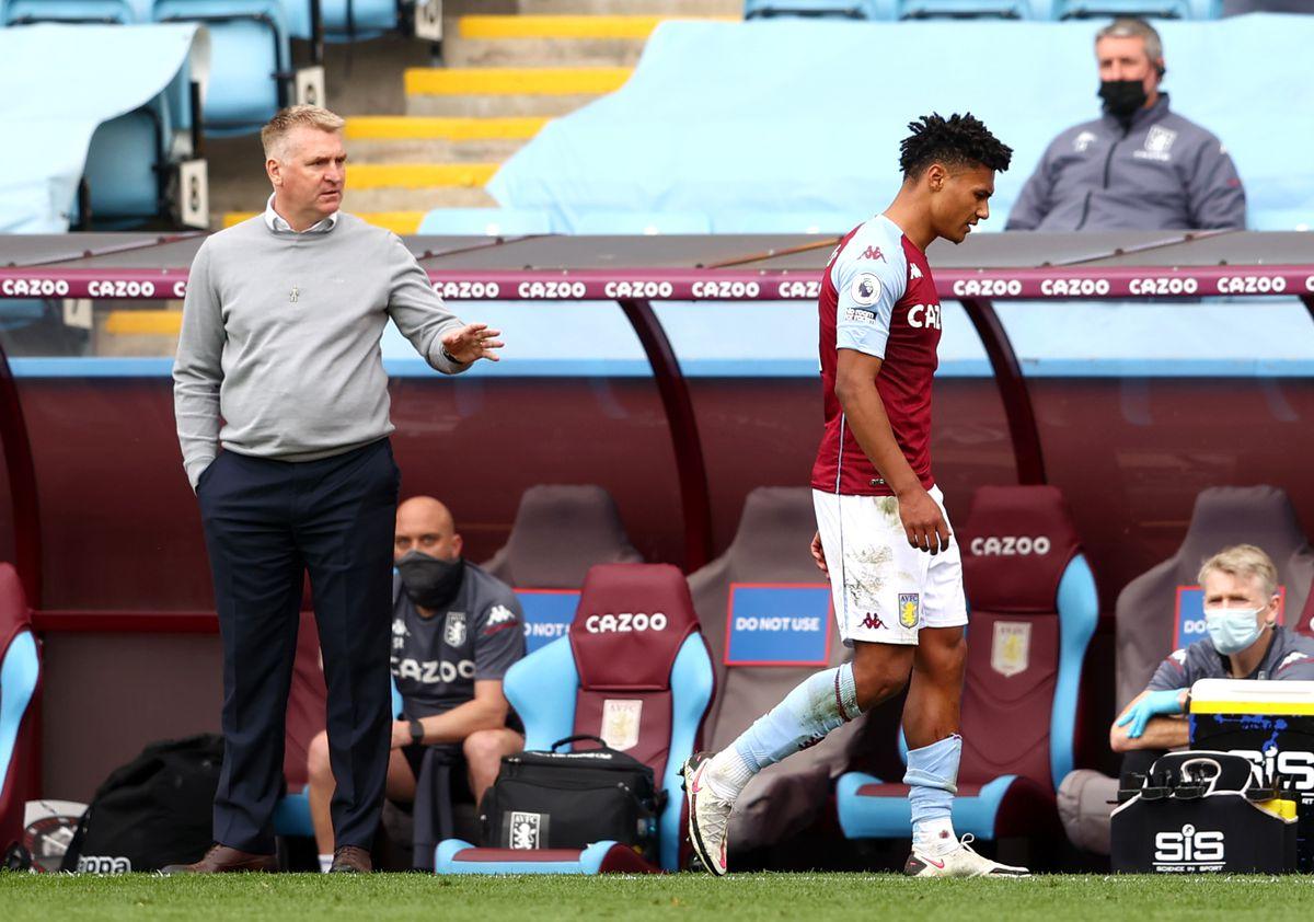 Aston Villa's Ollie Watkins (right) walks past Aston Villa manager Dean Smith after being sent off