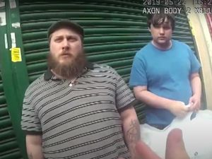 Caught on camera: Nathan Maynard-Ellis and David Leesley are stopped in the street by police