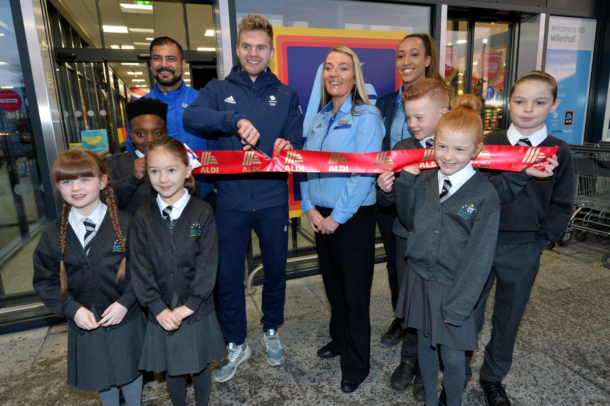 Marcus Ellis with store manager Lisa Kilmister and children from Stow Heath Primary