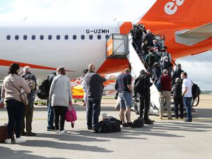 Passengers board an easyJet plane