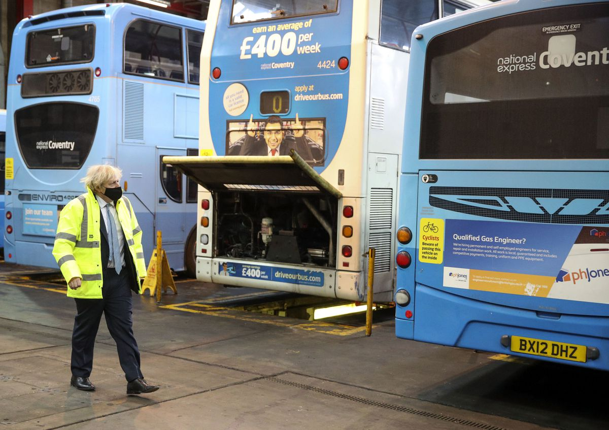 Prime Minister Boris Johnson during a visit to the National Express depot in Coventry