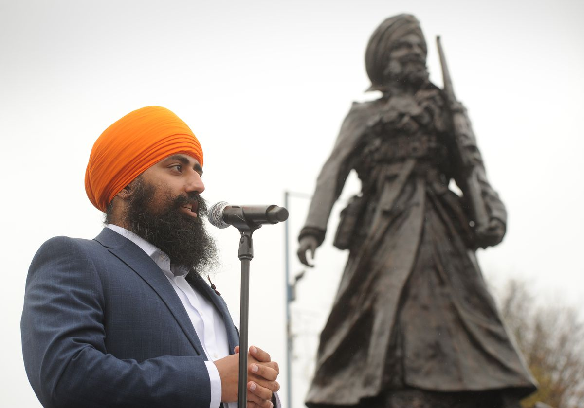 Jaswinder Sign speaking during the unveiling of the Lions of the Great War statue