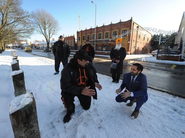 West Midlands Deputy Police and Crime Commissioner Waheed Saleem, with Wolverhampton Wrestling Club project manager Ranjit Singh, (back left-right) Amarjit Singh, Harpal Singh, and Guru Nanak Satsang Gurdwara vice president Gurmit Singh outside the Gurdwara