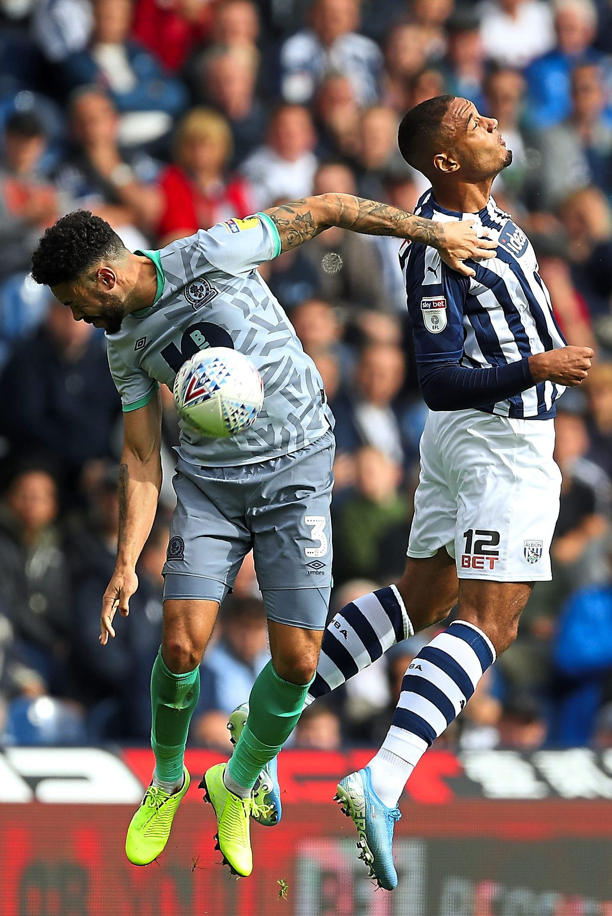 Derrick Williams of Blackburn Rovers and Kenneth Zohore of West Bromwich Albion. (AMA)