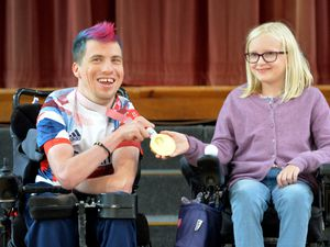 DUDLEY  COPYRIGHT TIM STURGESS EXPRESS AND STAR......06/10/2021 Elmfield School, Stoubridge, will be visited by Paralympian David Smith, who holds three Gold medals, is the most decorated GB Boccia player in history and carried the GB flag at the Tokyo Olympics closing ceremony, pictured with class 5 student Georgina age 10..