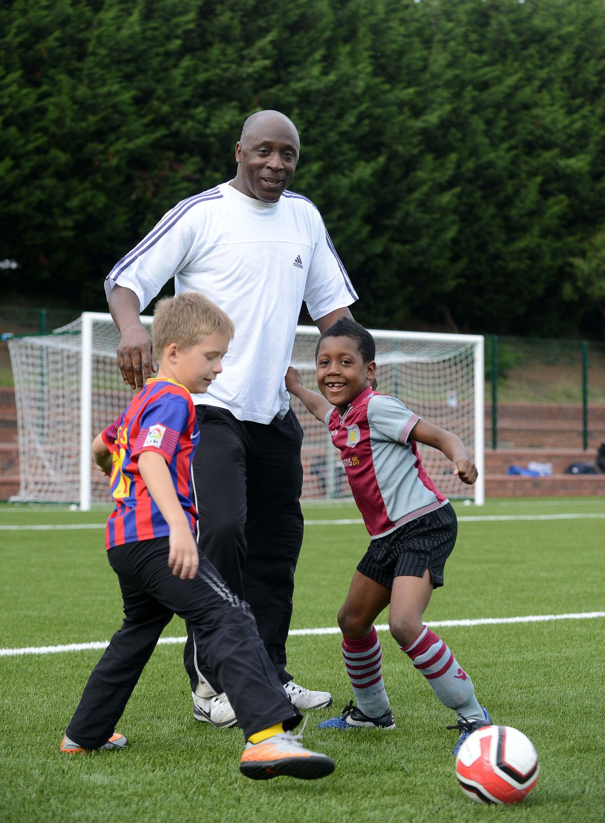 Garry tests the new 3G pitch with youngsters at Hadley Stadium Leisure Centre