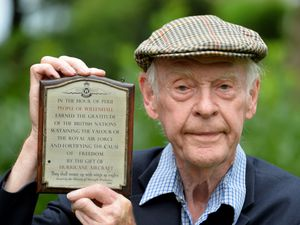 Trevor Matthews with the plaque recognising the efforts of people from Willenhall in assisting the war effort