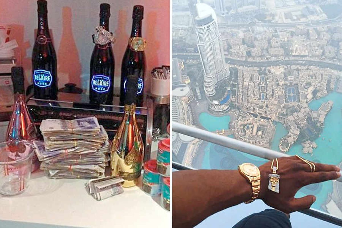 Booze and bundles of cash in a music video and showing off his gold watch and chain