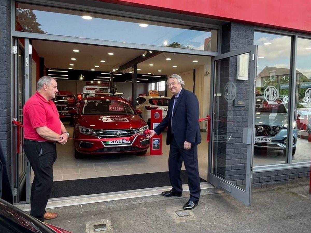 John Newey from Summit Garage, and on the right is Greg Webb, MG head of franchising UK, Ireland & RH Drive Markets