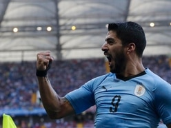 Luis Suarez sends Uruguay through with goal on his 100th appearance