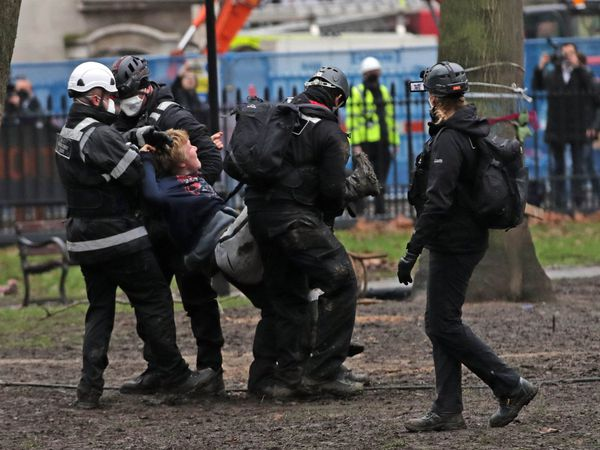A protester is removed