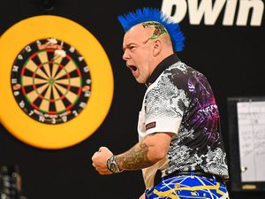 Former Grand Slam finalist Peter Wright in action at Aldersley Leisure Village last year     Picture: Lawrence Lustig/PDC