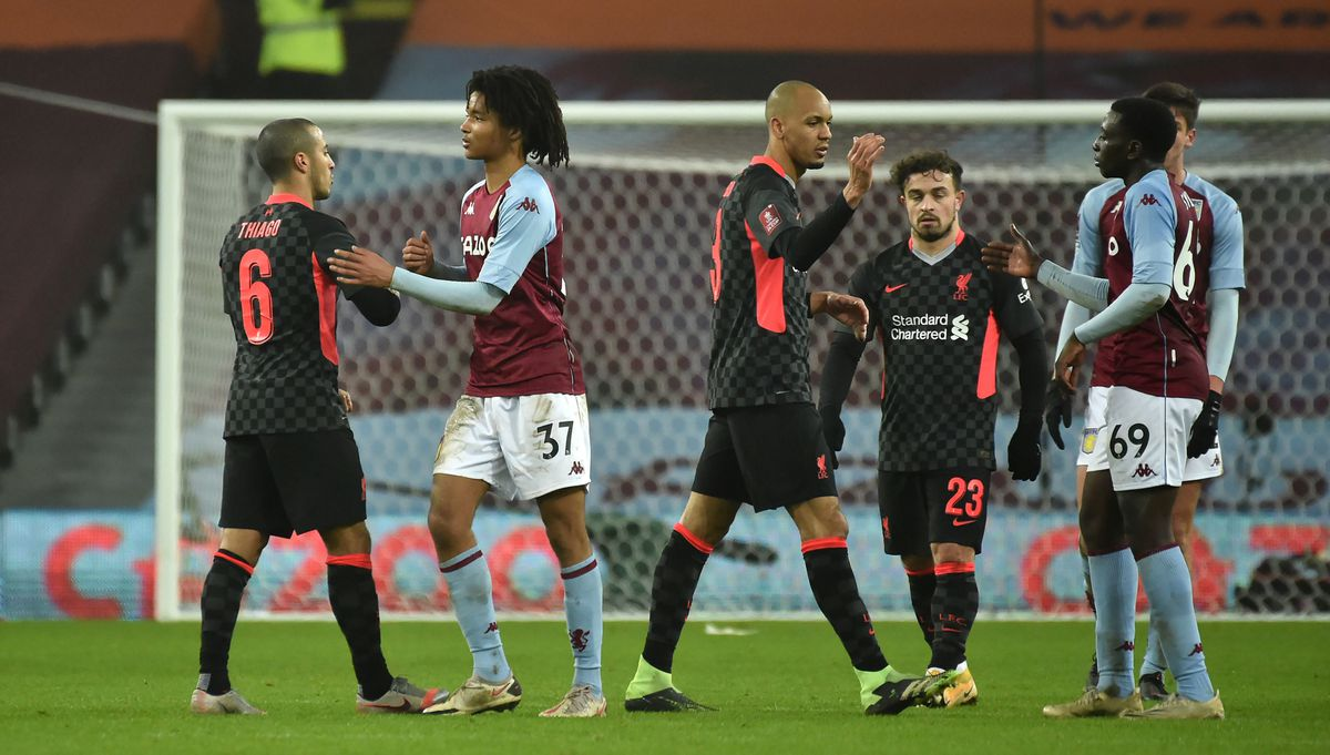 Liverpool's Thiago Alcantara (left) shakes hands with Aston Villa's Mungo Bridge after the Emirates FA Cup third round match at Villa Park,