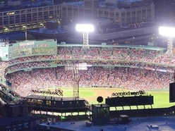 The first pitch at the Boston Red Sox game got extremely painful for one unlucky photographer