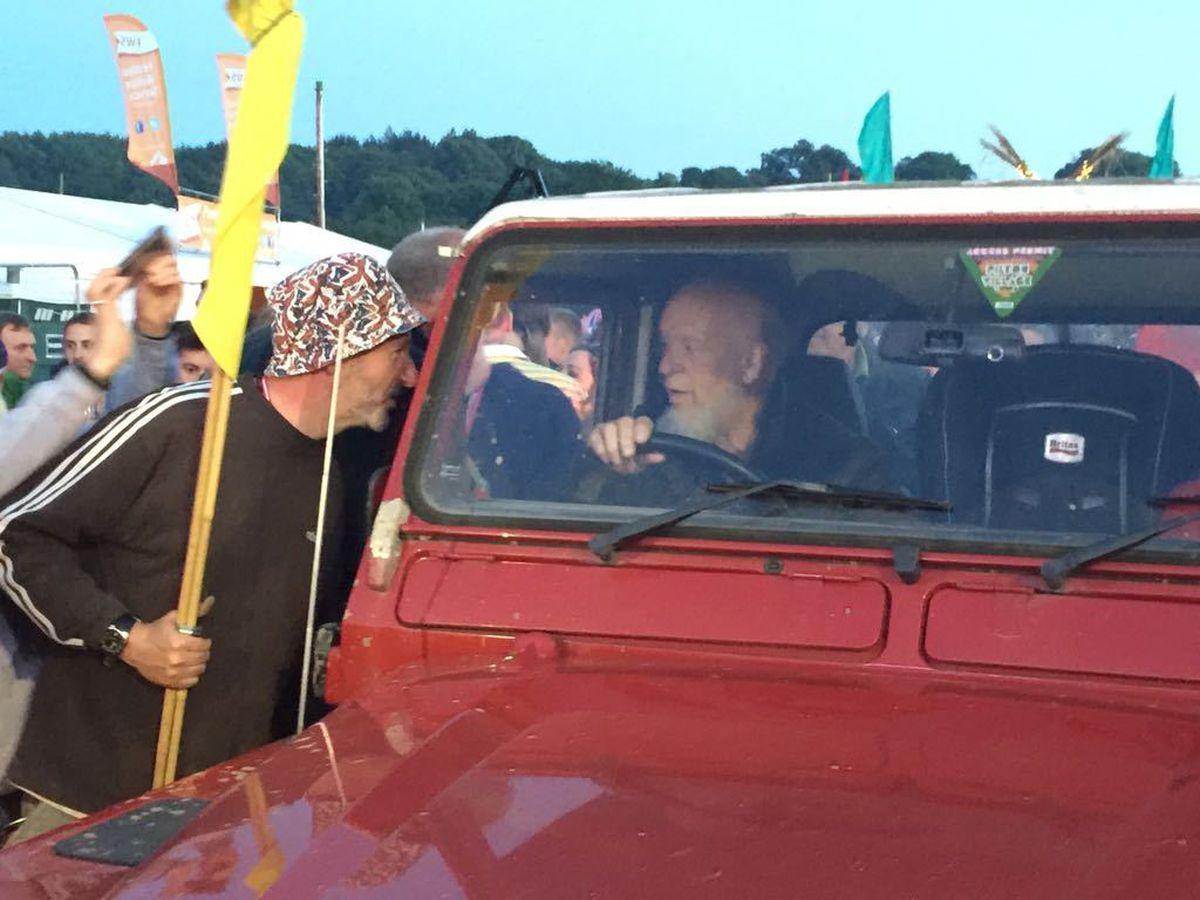 John Holding with his Wolves flag when he met Michael Eavis, Glastonbury Festival foudner