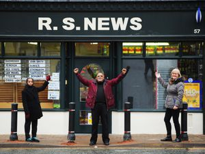 Open again following a ram raid in October, Rajendra Patel, centre, with wife Yamin, left, and Councillor Diane Coughlan