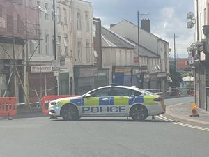 The police cordon at the top of Lower High Street, next to Market Place, in Wednesbury. Photo: David Wilkes