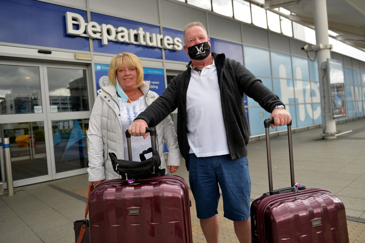 Colin Briton and Julie Sarnaz ahead of their flight to Spain