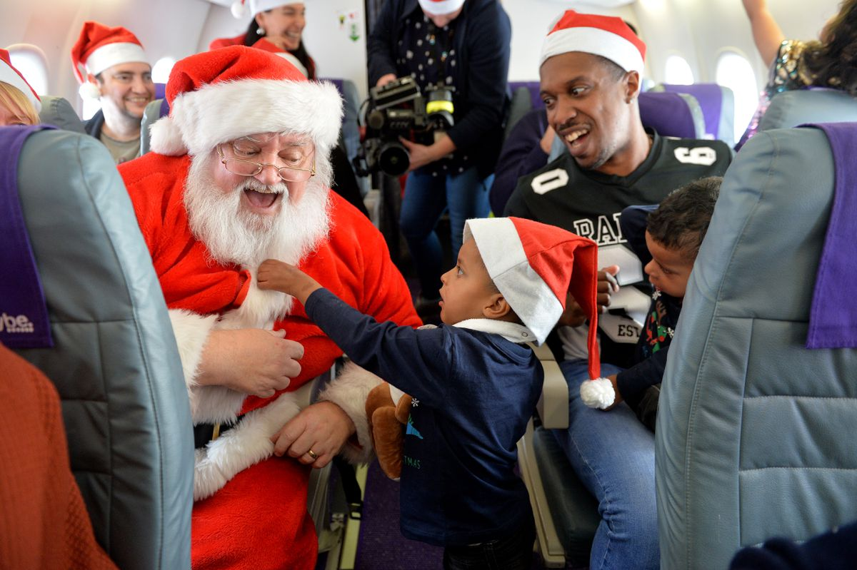 Lebron Facey from Brierley Hill checks if Santa's beard is real