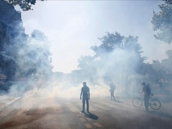 Police fire tear gas at protesters on day of dissent in Paris