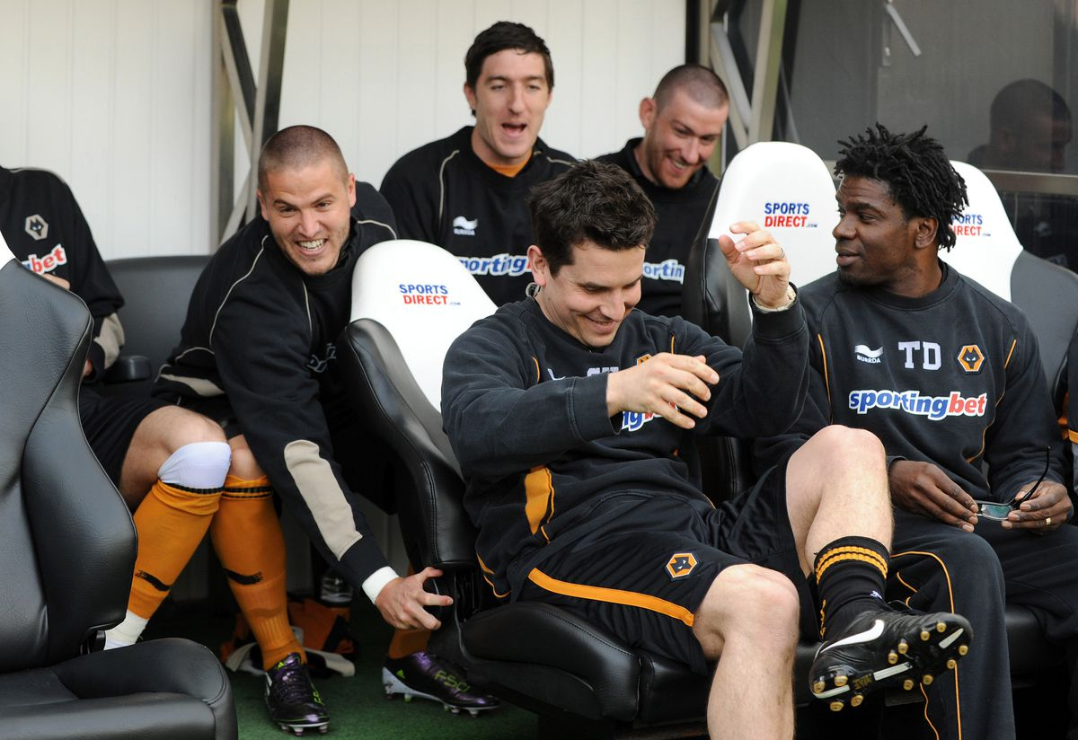 Michael Kightly of Wolverhampton Wanderers, turns back the seat of Steve Kemp Physio of Wolverhampton Wanderers.