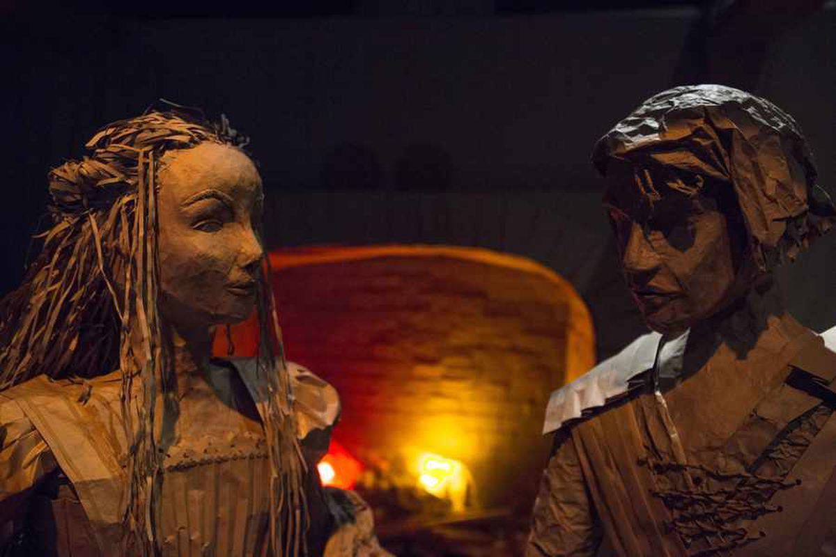 A life-size paper Romeo and Juliet give each other the eye in this piece from the exhibition