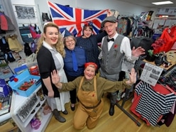 Age UK shop volunteers flies the flag for veterans with Remembrance tribute