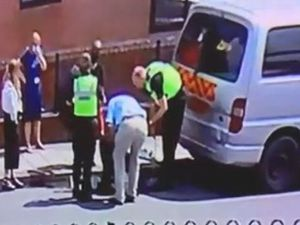 Police smashed windows to free the distressed dog
