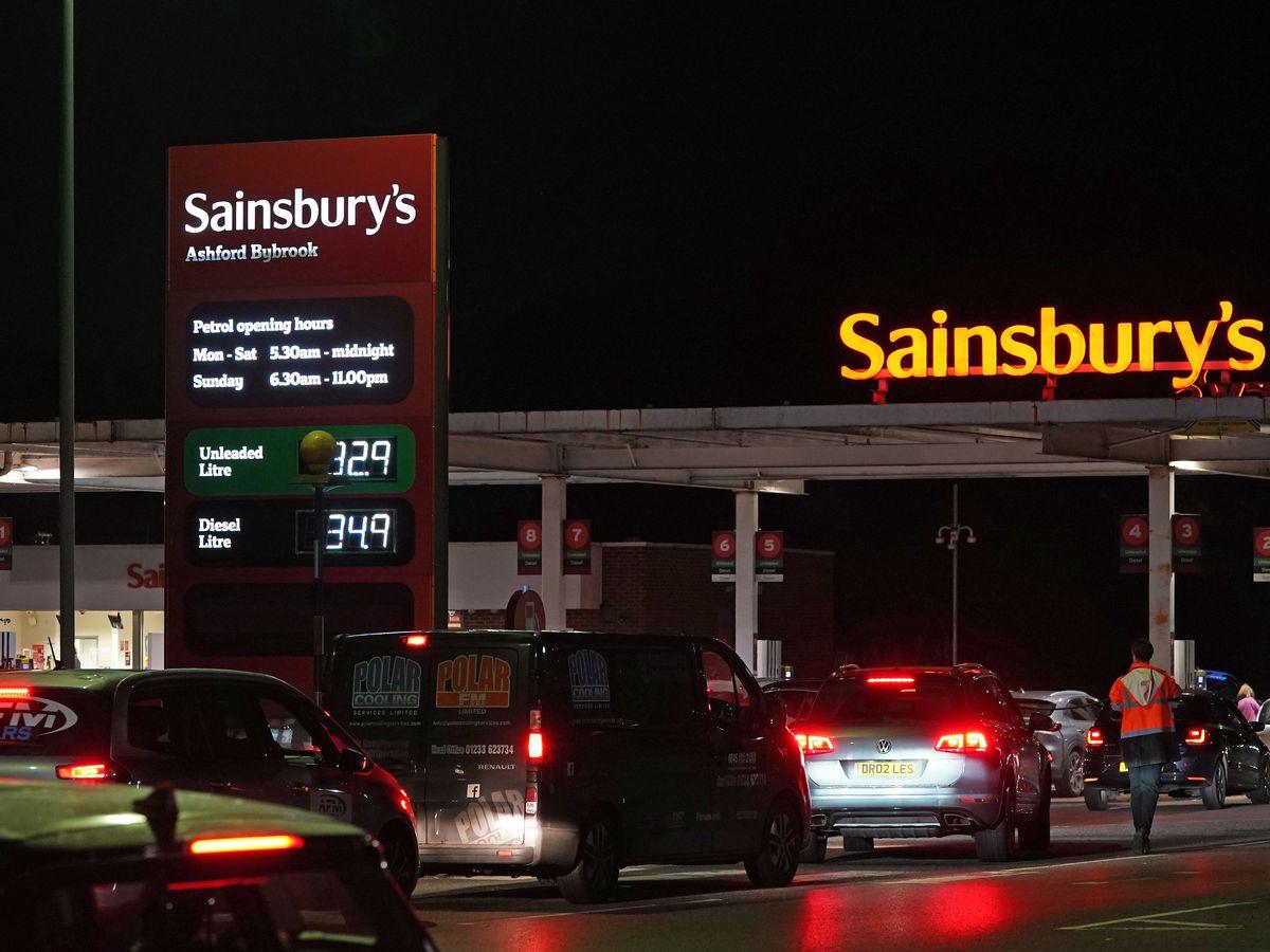 Cars queue for petrol