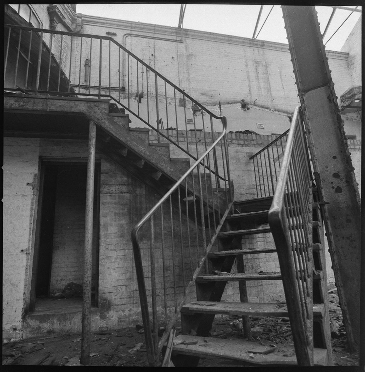 The stairs inside the shell of the empty building