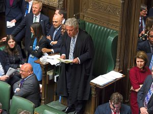 John Bercow speaks in the Commons, surrounded by MPs