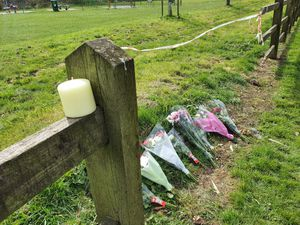 Floral tributes have been left at the scene in Laburnum Avenue, in Cannock