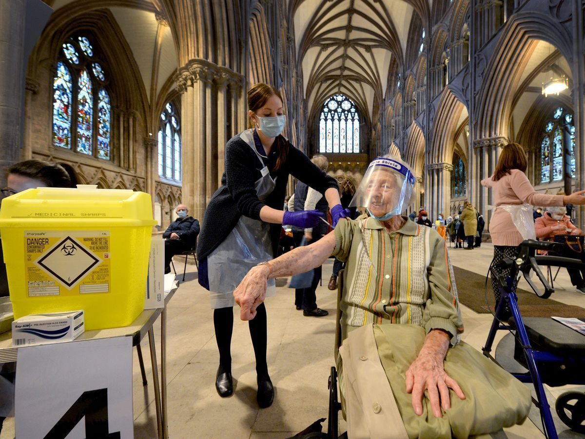 Irene Paterson, aged 91, from Lichfield receives the vaccine from Rachel Fletcher at Lichfield Cathedral