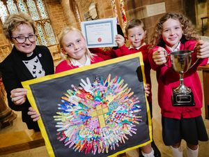 LAST COPYRIGHT SHROPSHIRE STAR JAMIE RICKETTS 28/09/2021 - Award to St Mary's CE Primary School in Albrighton presented by Civic Society at St Mary Magdalene Church. The theme was based on the Church itself. In Picture L>R: Vicar Mary Thomas, Victoria 8, Ted 8 and Bae 8.