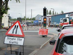 Temporary traffic lights causing congestion, at Britannia Road, Rowley Regis