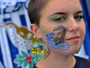 Chloe Davies with her design of Super Slav. She also sports specially made West Bromwich Albion earrings