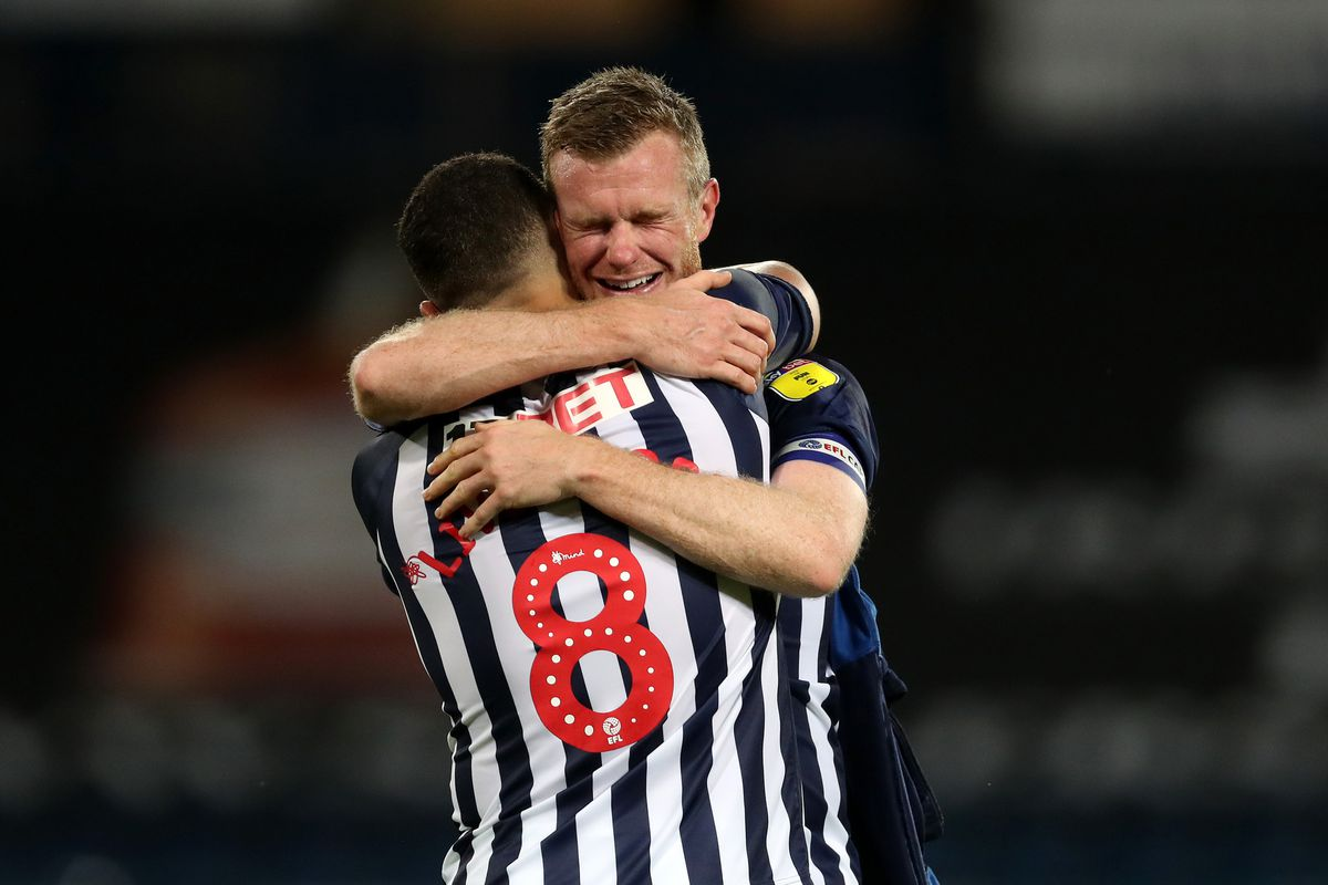 Chris Brunt of West Bromwich Albion and Jake Livermore of West Bromwich Albion embrace as they celebrate promotion to the Premier League on the pitch at the end of the match. (AMA)