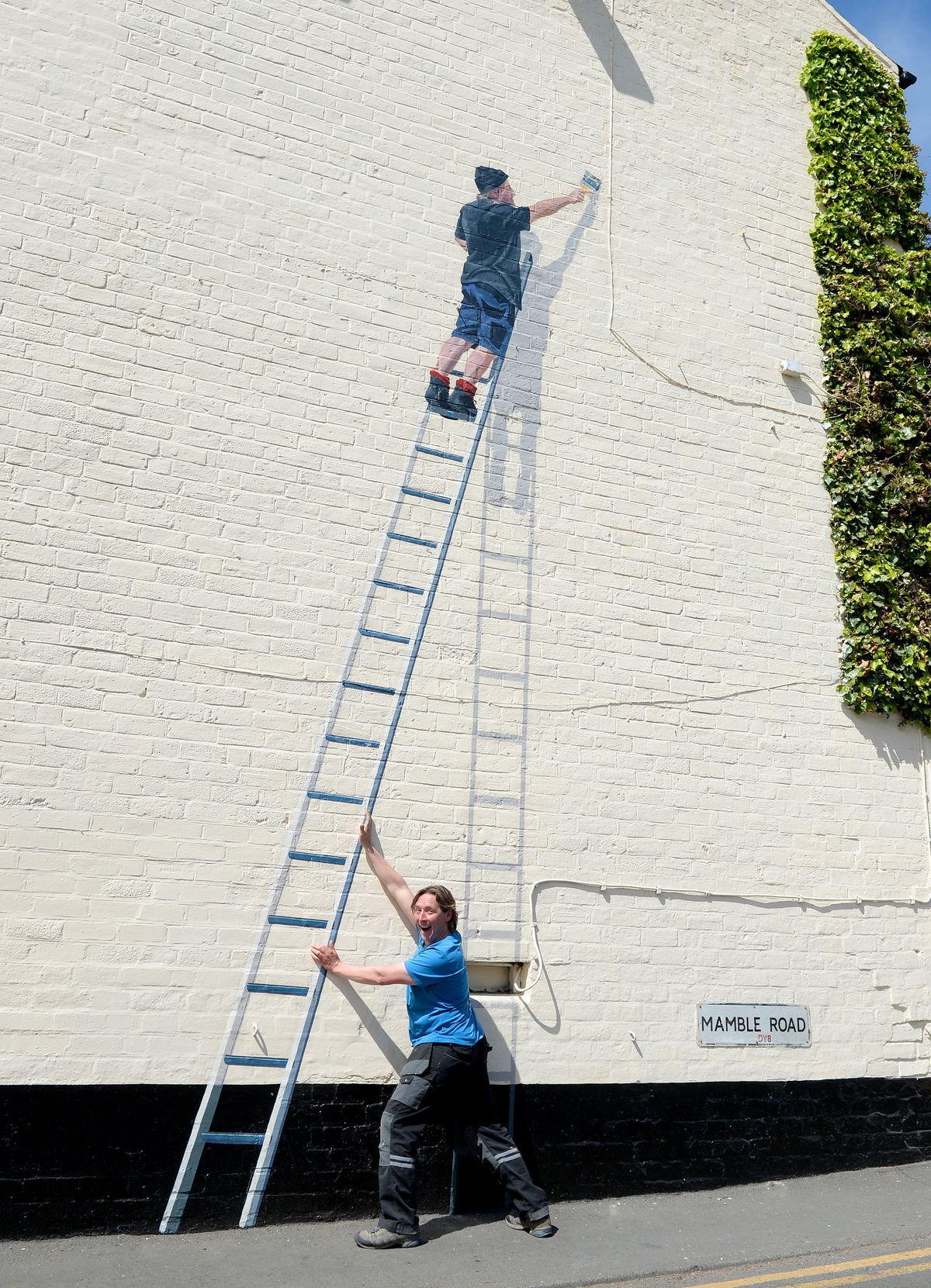 The unusual mural at Katie Fitzgerald's featuring landlord Eddy Morton painting the wall