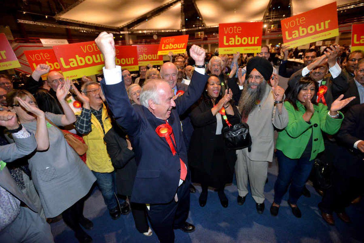 David Jamieson celebrates with Labour activists.