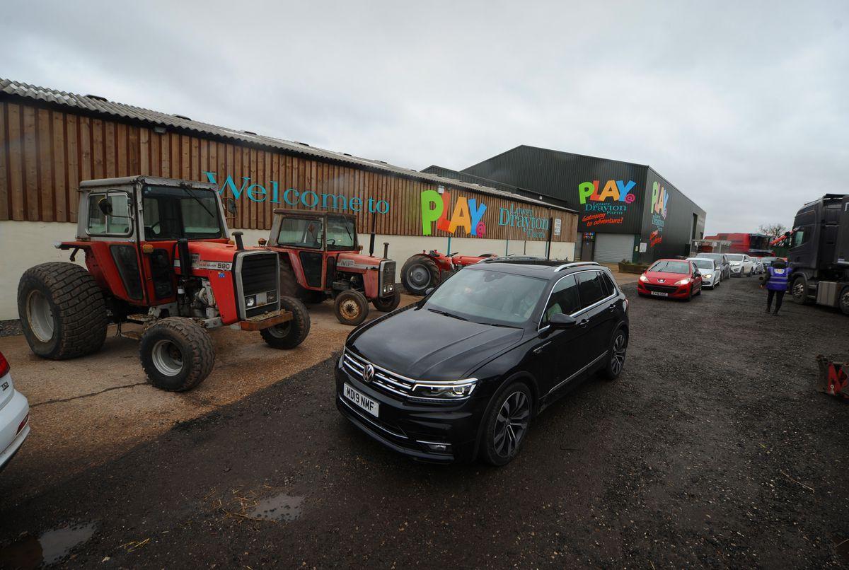 Cars travel through Lower Drayton Farm to order at the new drive-through burger bar