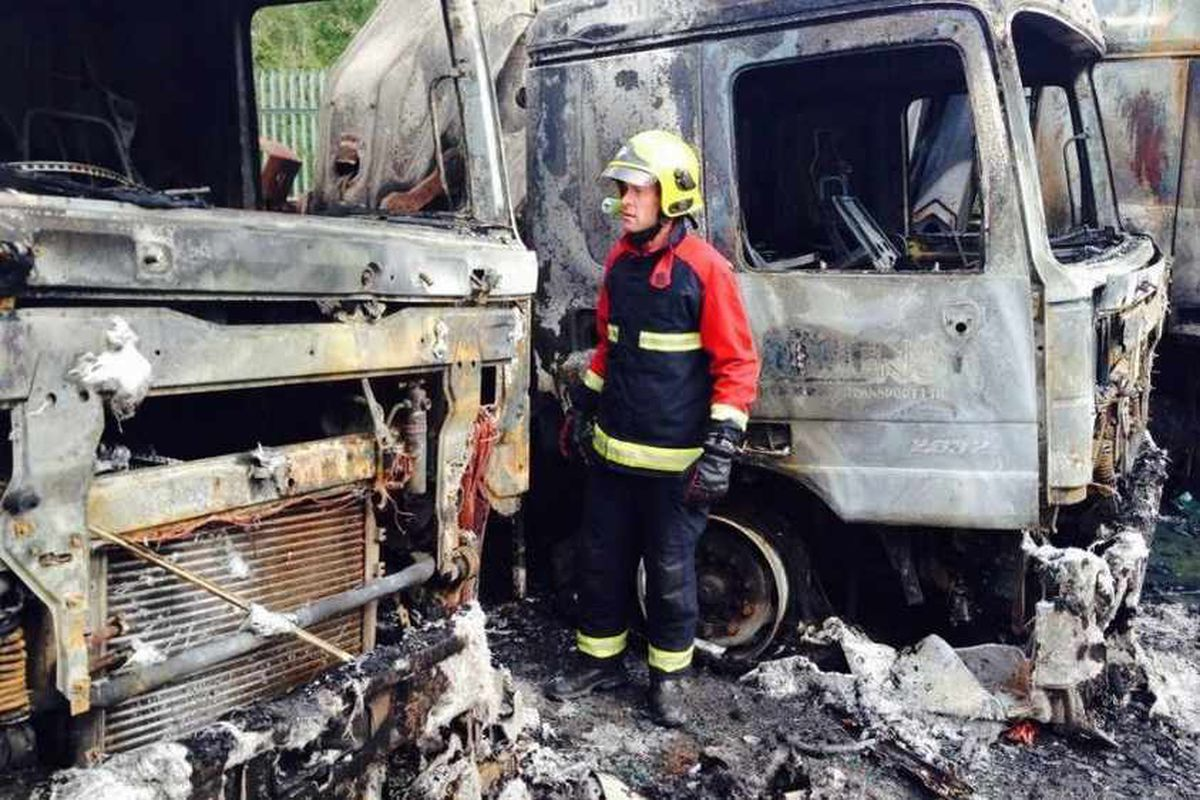 Firefighters tackle three-lorry blaze