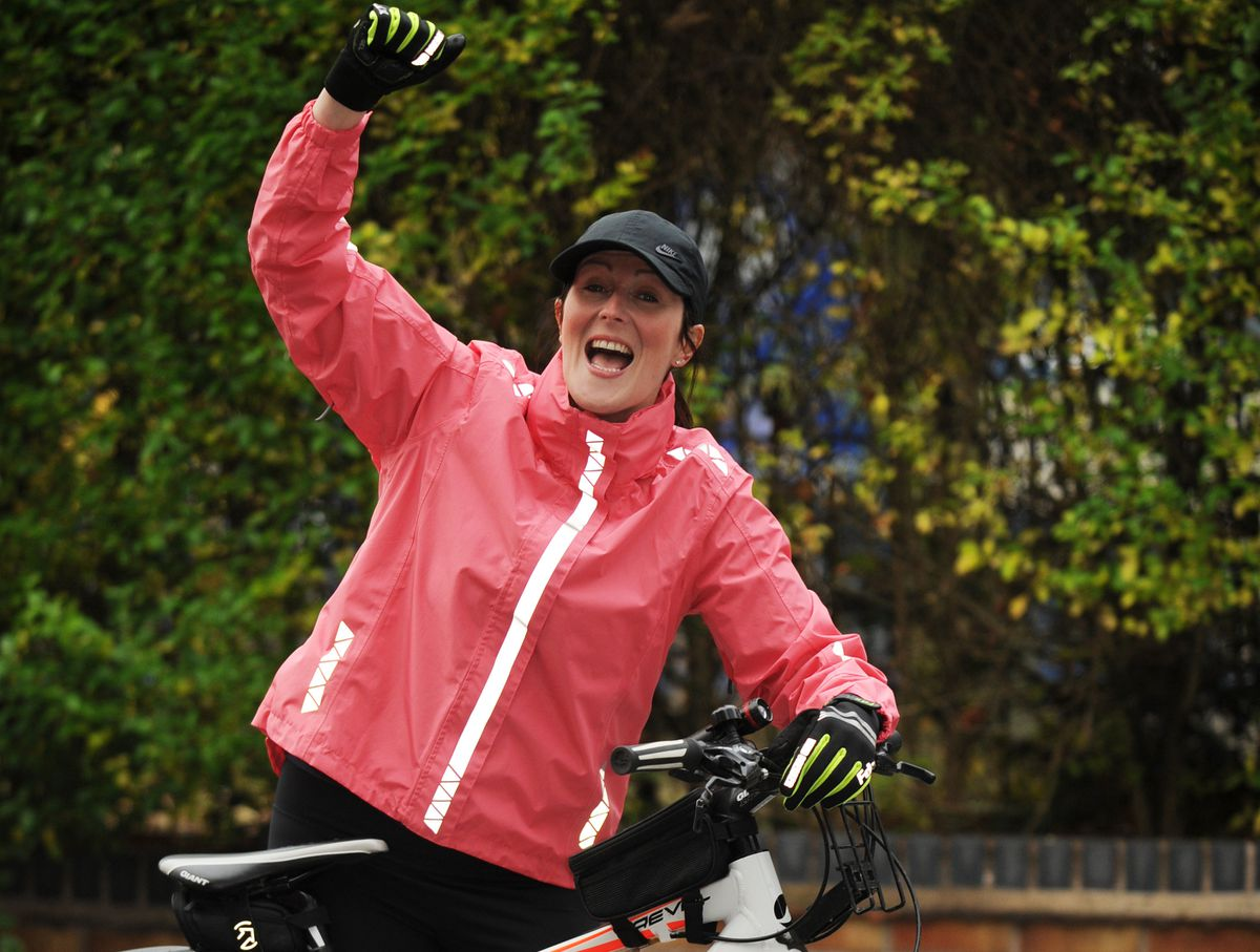 Celebrating after raising £950 cycling 150 miles, for Katharine House Hospice, senior staff nurse Clare Kirkbride, of Rugeley
