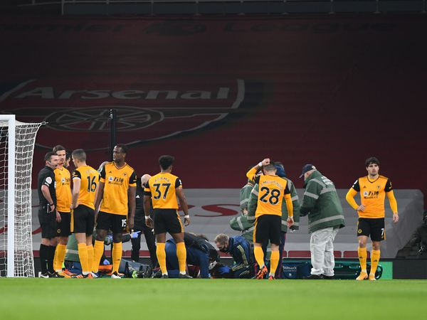 Raul Jimenez of Wolverhampton Wanderers lies injured receiving treatment with a head injury and is stretchered off the pitch. (AMA)