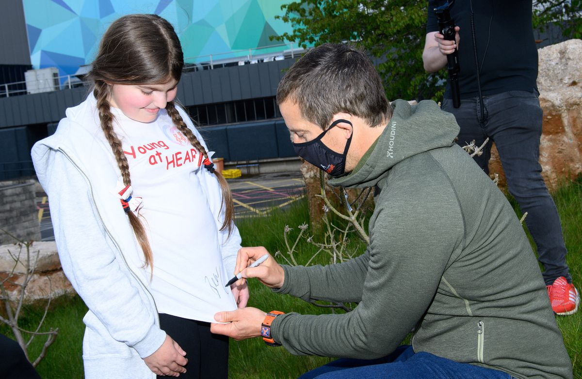 Bear Grylls with Rebecca Hampson, 11, from Young at Heart Photo: J Hordle / INhouse images