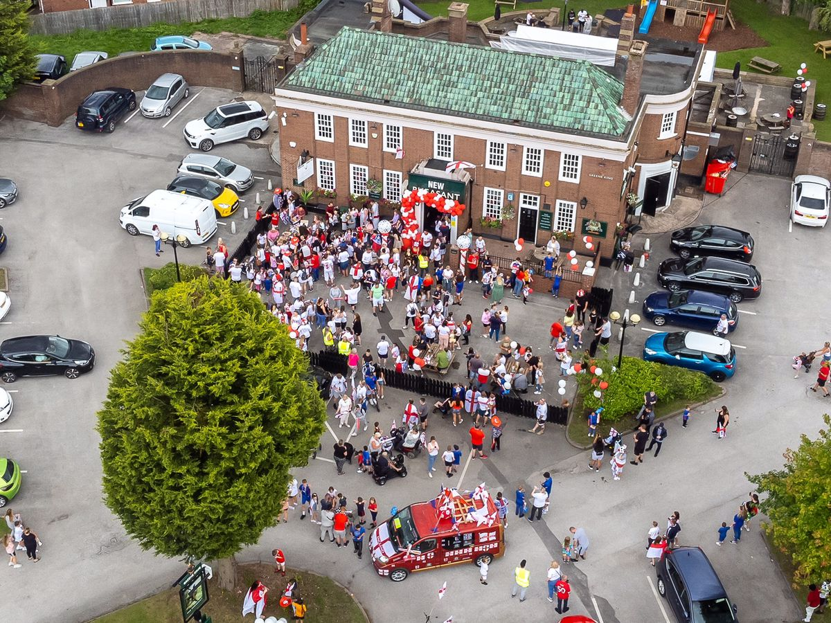 England fans march through Wednesfield ahead of the Euro 2020 final. Photo: Paul Turner