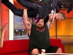 WATCH: Staffordshire strong man Eddie Hall bench presses BBC presenter Dan Walker