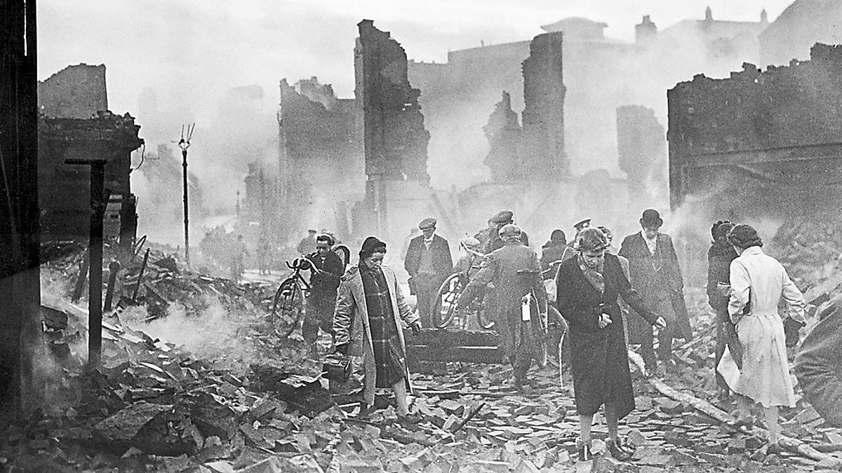 Picking through the rubble in the aftermath of the Coventry Blitz, a raid designed to devastate a city and break its people