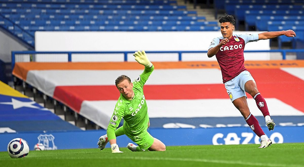 """Aston Villa's Ollie Watkins (right) scores their side's first goal of the game during the Premier League match at Goodison Park, Liverpool. Issue date: Saturday May 1, 2021. PA Photo. See PA story SOCCER Everton. Photo credit should read: Michael Regan/PA Wire.   RESTRICTIONS: EDITORIAL USE  ONLY No use with unauthorised audio, video, data, fixture lists, club/league logos or """"live"""" services. Online in-match use limited to 120 images, no video emulation. No use in betting, games or single club/league/player publications."""